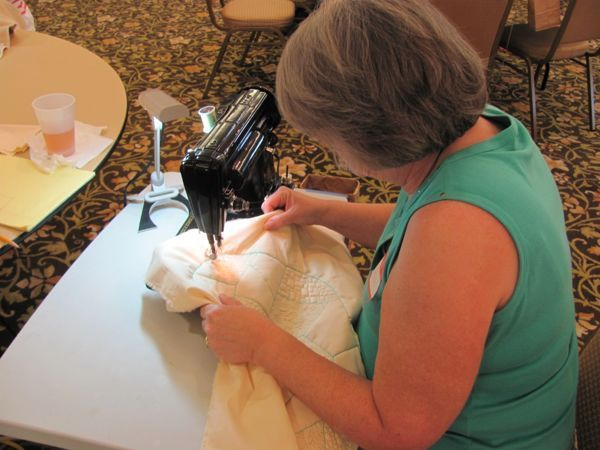 Janice doing beautiful work on her Singer sewing machine