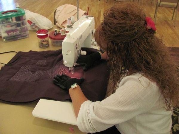 Laurie working hard on her maroon stocking