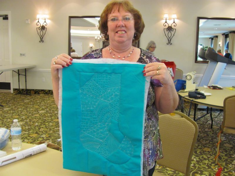 Sandy M. with her beautiful teal stocking project
