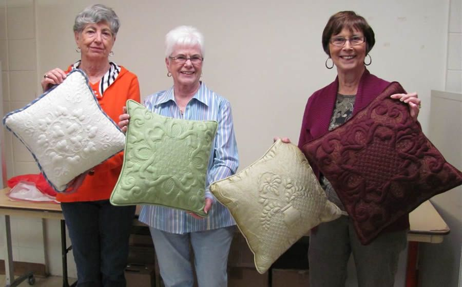 Carolyn, Chic and Juliet with their trapunto pillows