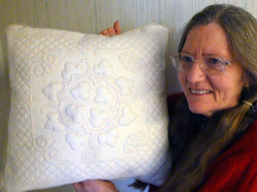 Eva Nipp with her pretty oak wreath pillow